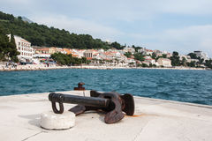 Old rusty ship anchor in the harbor in Podgora, Croatia Stock Images