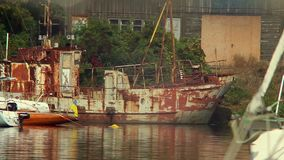 Old rusty ship in harbor, abandonment, destruction, wrecks. Stock footage stock footage