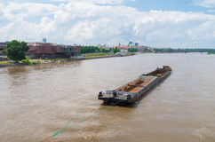 Old rusty ship. Picture of rusty ship on Wisła river.  Panorama of Warsaw in background Stock Photo