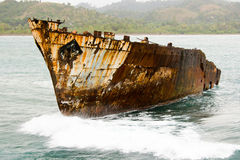 Old rusty ship in a sea. After shipwreck near coast stock photo
