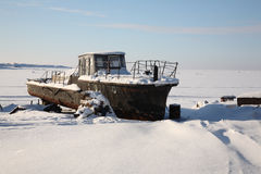 Old rusty ship in snow. Royalty Free Stock Photos