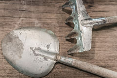 Old and rusty Shovel and lecher on top of wooden table Royalty Free Stock Photo