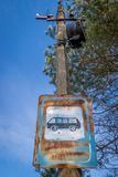 An old rusty sign with Cyrillic lettering on a lamppost. royalty free stock photography