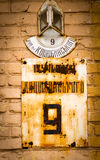 Old rusty sign with the street name Royalty Free Stock Photo