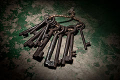 Old rusty skeleton keys on wood background Royalty Free Stock Photos