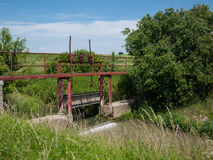 Old rusty sluice on the river Royalty Free Stock Photography
