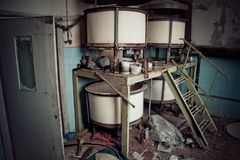 Old rusty small vats in abandoned chemical factory stock photography