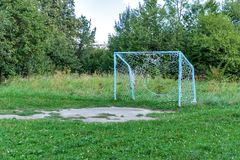 Old rusty soccer goal after game, nostalgia concept.  Stock Photo