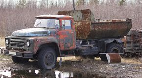 Old rusty Soviet dump truck stock photo