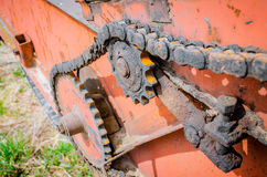 Old rusty species of part of agricultural machinery in rural areas. Royalty Free Stock Images