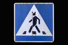 Old road sign `Pedestrian crossing` isolated on black. stock illustration