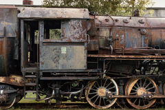 Old, rusty steam egine. Old rusty steam engine. Out of work Stock Image