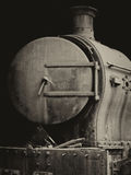 Old rusty steam locomotive with door and chimney Stock Photography