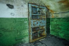 Old rusty steel armored door in abandoned soviet bomb shelter Stock Images