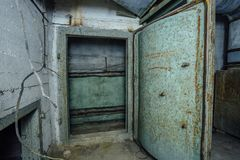 Old rusty steel armored door in abandoned soviet military bunker. Sevastopol stock image