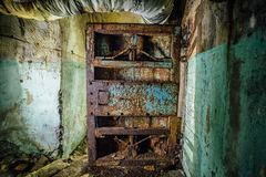 Old rusty steel armored door in abandoned soviet military bunker Stock Photos