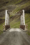 Old rusty Steel bridge and rural road Stock Photo