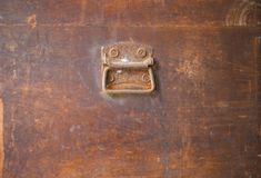 Old rusty steel handle on wooden box. Background Royalty Free Stock Photography