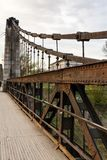 Old rusty steel suspension bridge Stock Image