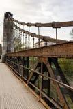 Old rusty steel suspension bridge Stock Image