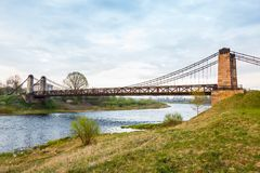 Old rusty steel suspension bridge Royalty Free Stock Photos