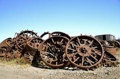 Old rusty steel tractor wheels Stock Photo