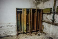Old rusty storage lockers in abandoned bomb shelter royalty free stock photography