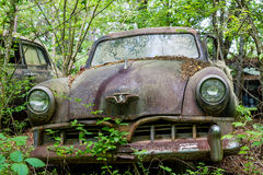 Old Rusty Studebaker. SOUTH BEND, INDIANA - May 11, 2015:   Studebaker was an American wagon and automobile manufacturer based in South Bend, Indiana. Founded in Royalty Free Stock Image
