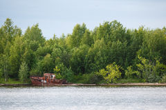 Old rusty sunken ship in water Royalty Free Stock Photo