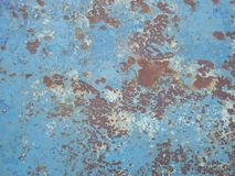 Old rusty surface. Scratched metal painted metal background. Dirty and Old metal texture background. Metal wallwith peeling pain royalty free stock photography