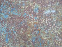 Old rusty surface. Scratched metal painted metal background. Dirty and Old metal texture background. Metal wallwith peeling pain royalty free stock photos