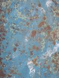 Old rusty surface. Scratched metal painted metal background. Dirty and Old metal texture background. Metal wallwith peeling pain royalty free stock images