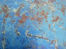 Old rusty surface. Scratched metal painted metal background. Dirty and Old metal texture background. Metal wallwith peeling pain stock image