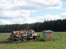 Old rusty tank truck in front of forest Stock Images