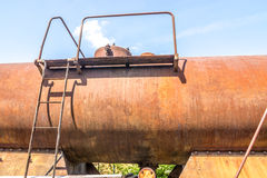 Old rusty, tank wagon, top detail with bridge, handles and valve Royalty Free Stock Photos