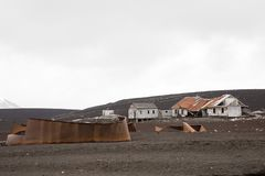 Old rusty tanks and buildings for the remains of the old whaling station at Whalers Bay, Deception Island, Antarctica royalty free stock photos
