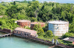 Old Rusty Tanks on Venice Canal Stock Photos