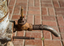 Old rusty tap column Royalty Free Stock Photo