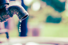 Old rusty tap leaking water vintage style Stock Photos