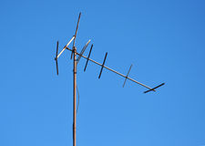 Old rusty television antenna. Television antenna against blue sky Royalty Free Stock Images