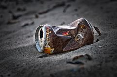 Old rusty tin can. Left in the dunes this tin can. People should be aware that it takes over 30 years before its vanished i.e. destroyed by the weather royalty free stock image