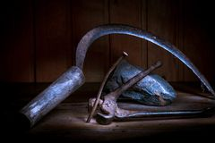 Old rusty tool in the dark room, totally dark place, playing with lights, old stuff, serb, rock, nail, nippers,. Old rusty tool in the dark room, totally dark royalty free stock photography