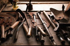 Old rusty tools. Grungy old rusty tools on workbench Stock Photography
