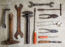 Old rusty tools arranged on the floor. Background sample Stock Photos