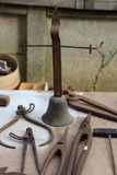 Old rusty tools and bell Stock Image