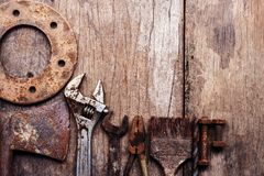 Old rusty tools on old wood background. Old rusty tools on a old wood background. vintage photo royalty free stock photo