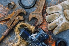 Old rusty tools for plumbing work. View from above royalty free stock image
