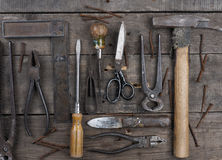 Old rusty tools. Old and rusty used tools on a rustic wooden table royalty free stock images