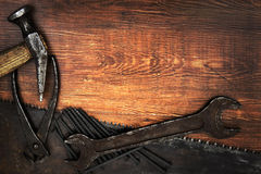 Old and rusty tools. On wooden background stock photos