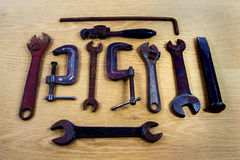 Old Rusty Tools. On a wooden background royalty free stock photography